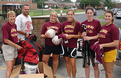 SU volleyball players donate athletic equipment
