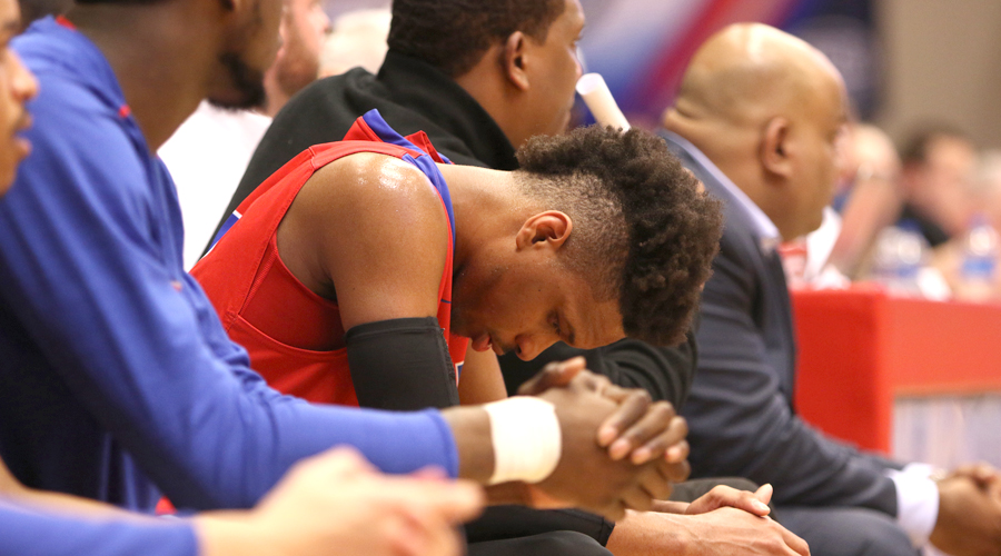 Sophomore Rob Whitfield sits on the Dragon bench in the stages of an 80-65 loss to Florida Southwestern State on Wednesday in the second round of the NJCAA Tournament at the Sports Arena. (Joel Powers/Blue Dragon Sports Information)