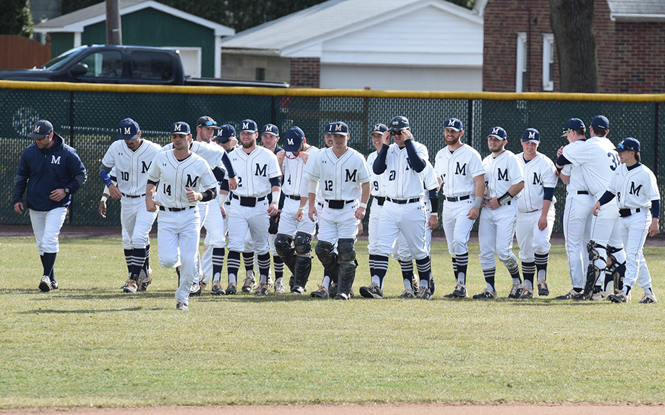 The Greyhounds head in from left field after a final meeting before hosting New Jersey City University at Gillespie Field during the 2019 season.