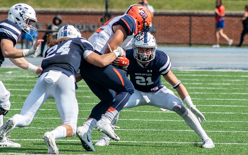 Nick Zambelli and Jackson Buskirk make a tackle versus Gettysburg College at Rocco Calvo Field.