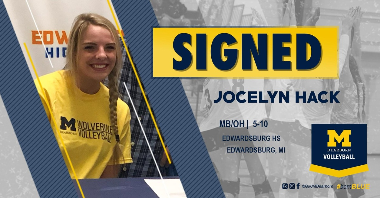 Hack signs with UM-Dearborn volleyball