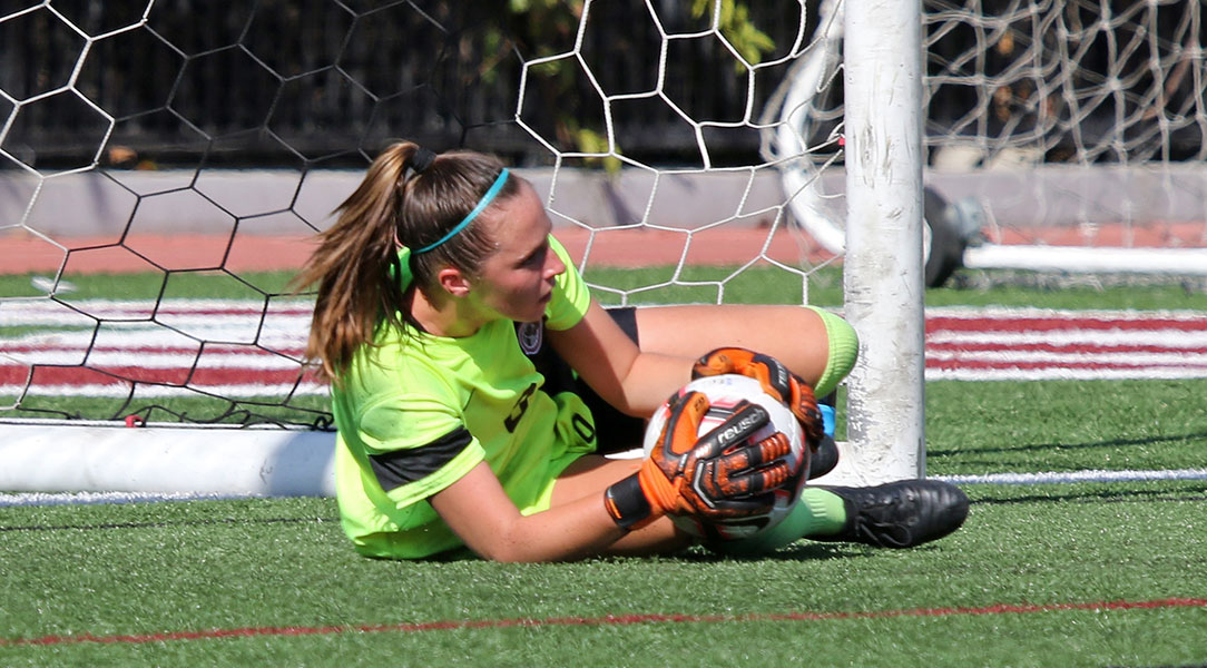 Kelsey Bland makes a diving save.