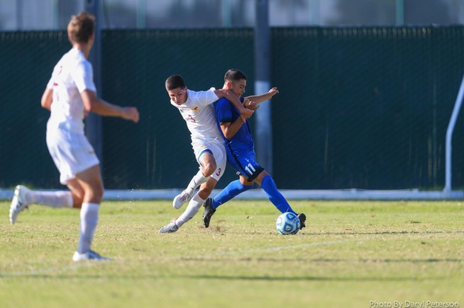 Bryan Villalobos battles with a Desert player for the ball in the Falcons 2-0 win