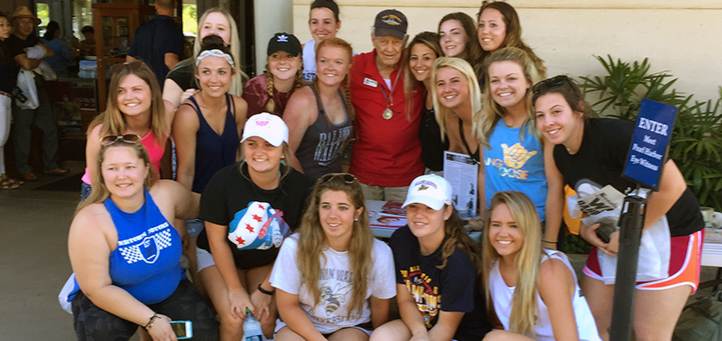 Softball team poses with Pearl Harbor survivor Robert Lee