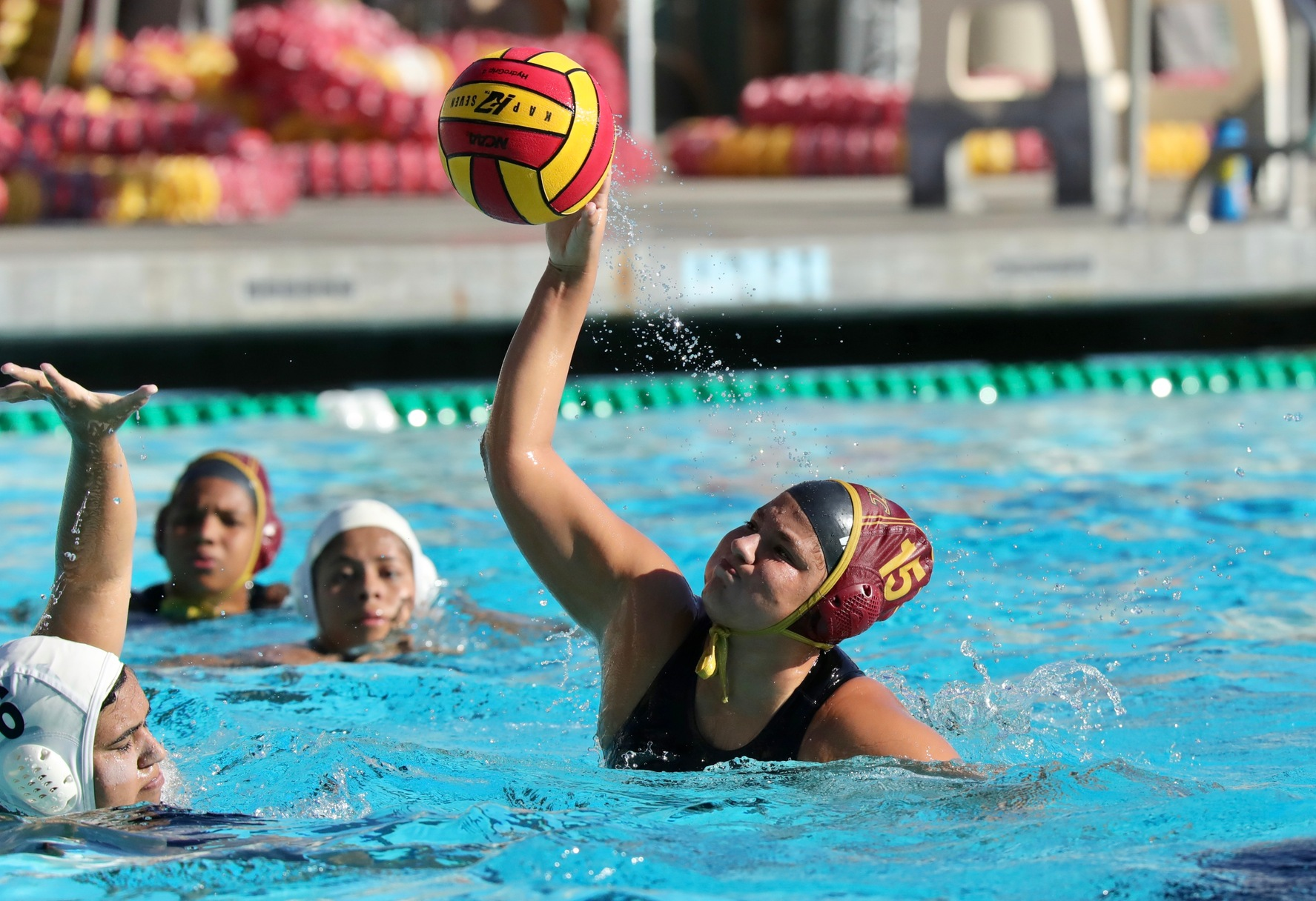 Lancer Fernandez Alvarez fires in one of her three goals in Wednesday's victory at the PCC Aquatic Center, photo by Michael Watkins.