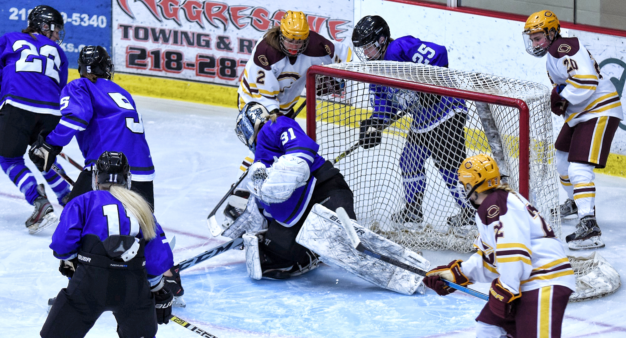 Amanda Flemming (#2) follows the puck slide into the net for the Cobbers' in their 3-1 win over Finlandia.