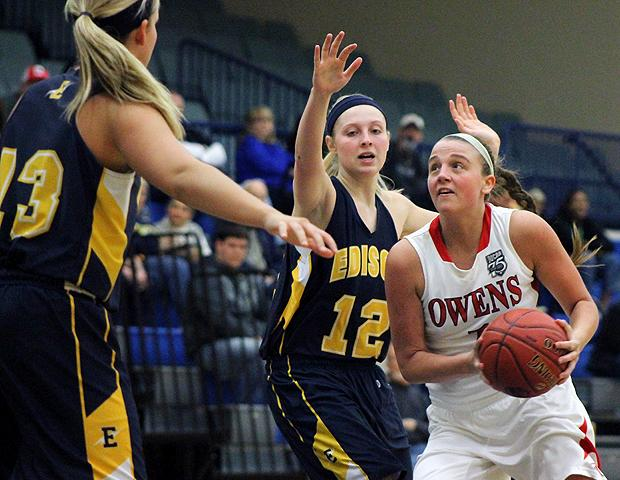 Paige Wright drives the lane against Edison in today's district semifinal. Photo by Geoff Roberts/Owens Sports Information