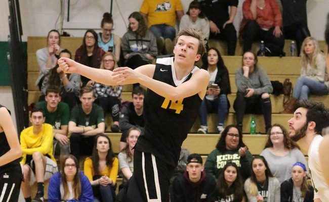 Chris Corcoran (14) with one of his 8 digs in the match -- Photo by Ed Webber