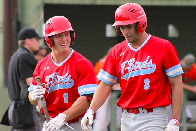 Pauly Steffenson and Kelby Richardson share a laugh after Richardson scored in the second inning. (Photo by Aaron Webster)
