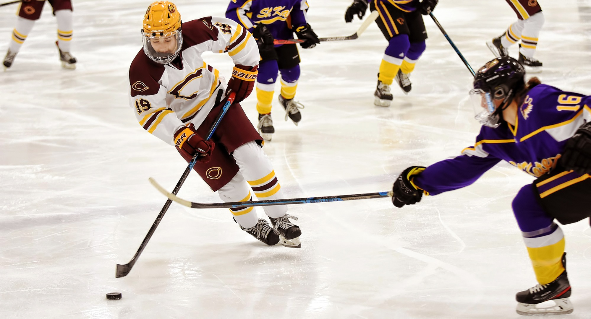 Freshman Kenley Anderson rushes the puck up the ice in the second period of the Cobbers' game with St. Kate's. Anderson scored her first collegiate goal in the win.