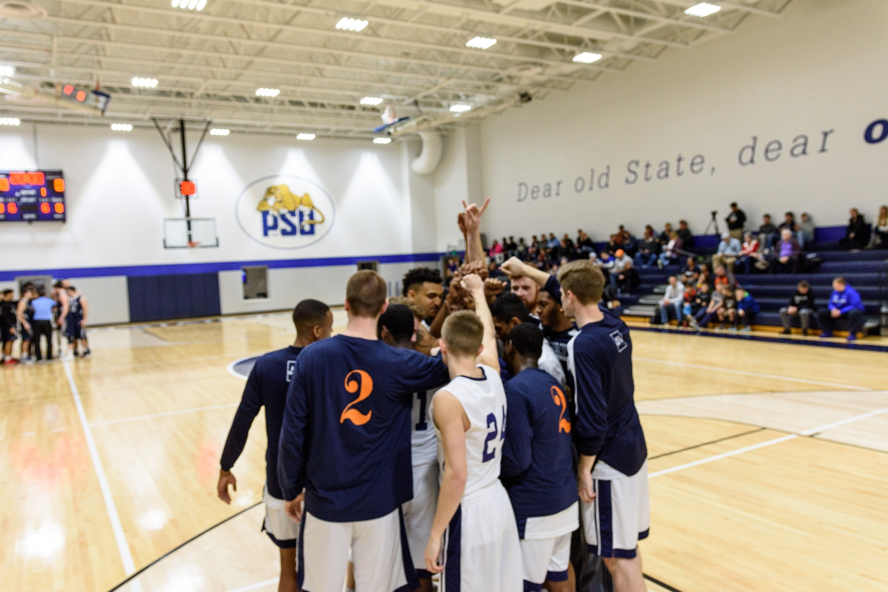 Penn State York Men's Basketball huddles before a home playoff game.