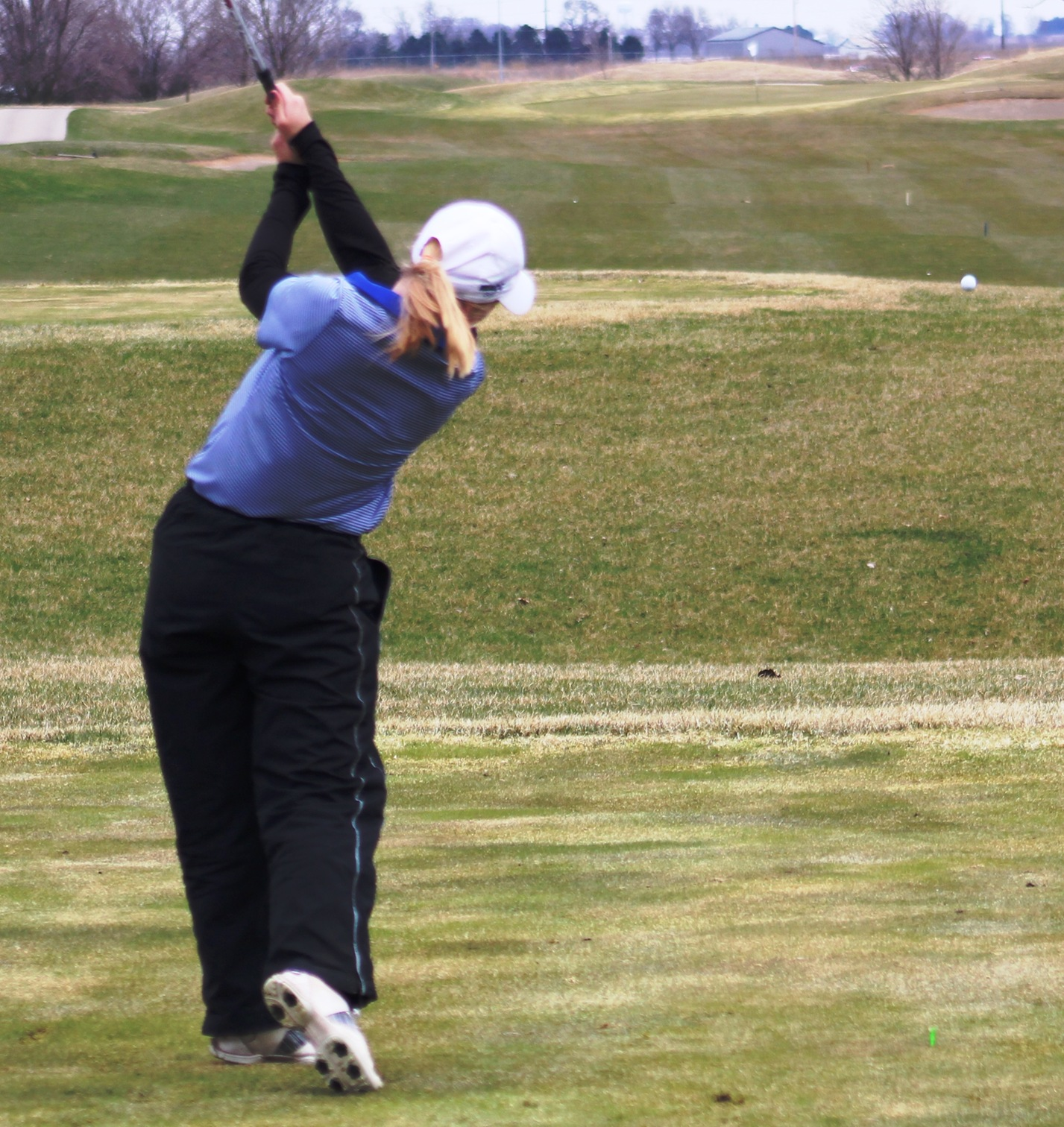 NIACC's Courtney Tusler tees off during the first round of the regional golf tournament last Friday in Ankeny.