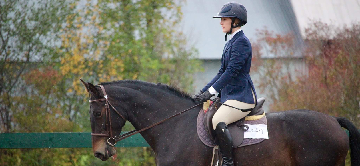 An equestrian student-athlete rides during a show.