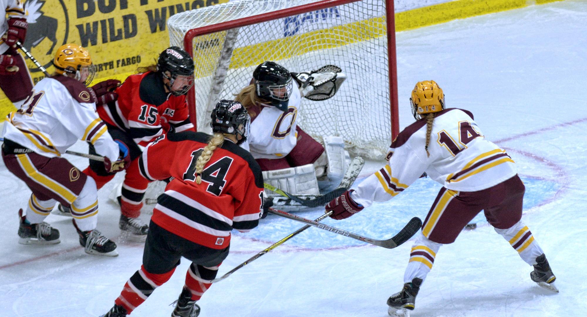 Callie Fagerstrom (#14) clears out the front of the net for Brittany Boss to make a save. Fagerstrom had a goal and an assist in the Cobbers' series with #7 Wis.-River Falls.