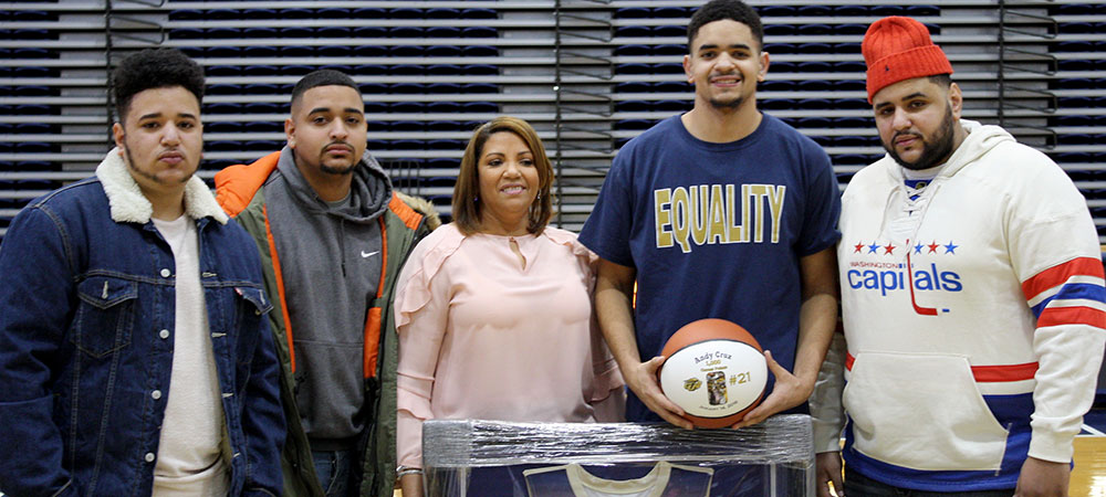 Andy Cruz and his family on Senior Day before the start of the basketball game.