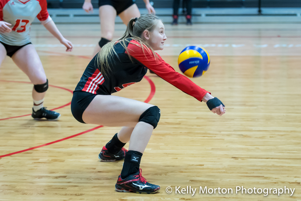 U of W's Emma Parker digs up an Alberta swing during action Saturday night at the Duckworth Centre. (Kelly Morton photo)