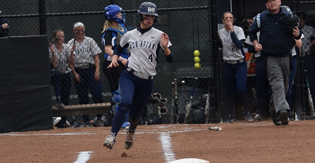 Kat Spilman '19 rounds first base on a hit versus Elizabethtown College at Blue & Grey Field.