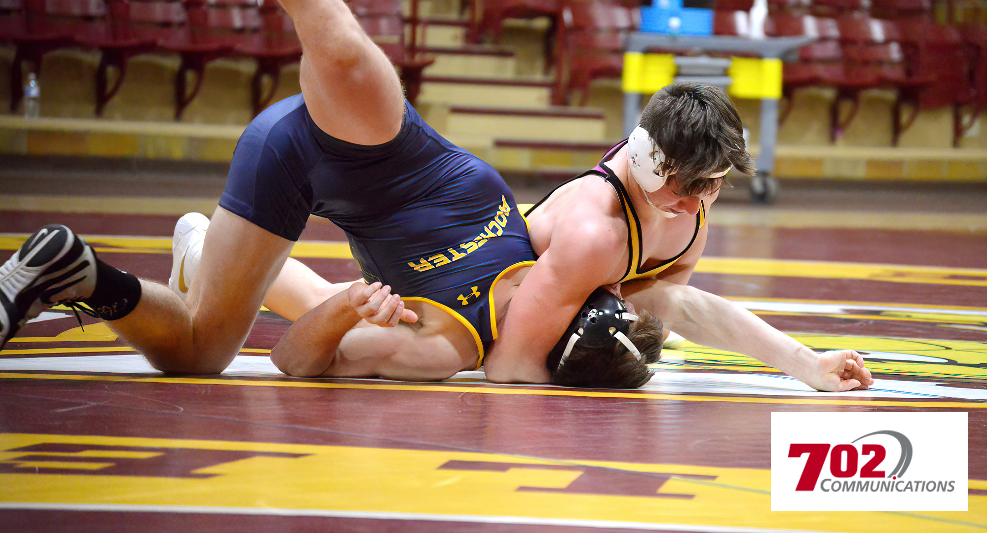 Tyler Bents gets his nationally-ranked opponent in a headlock during his match at 165 during the Cobbers' dual with RCTC.