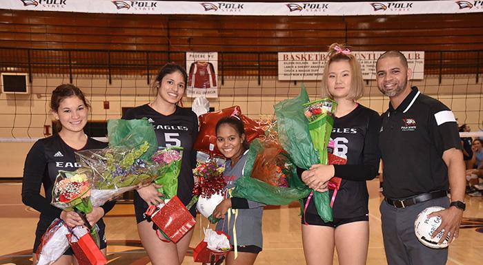Sophomores Nicole Boots, Alejandra Sanabria, Keisha Santana, and Phoebe Wu join Head Coach German Del Valle on court for pregame recognition. (Photo by Tom Hagerty, Polk State.)