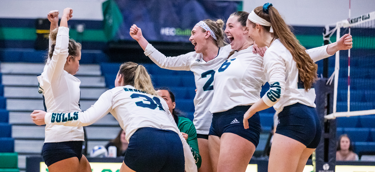 The women's volleyball team celebrates a point in the CCC Semifinal win over Salve Regina.