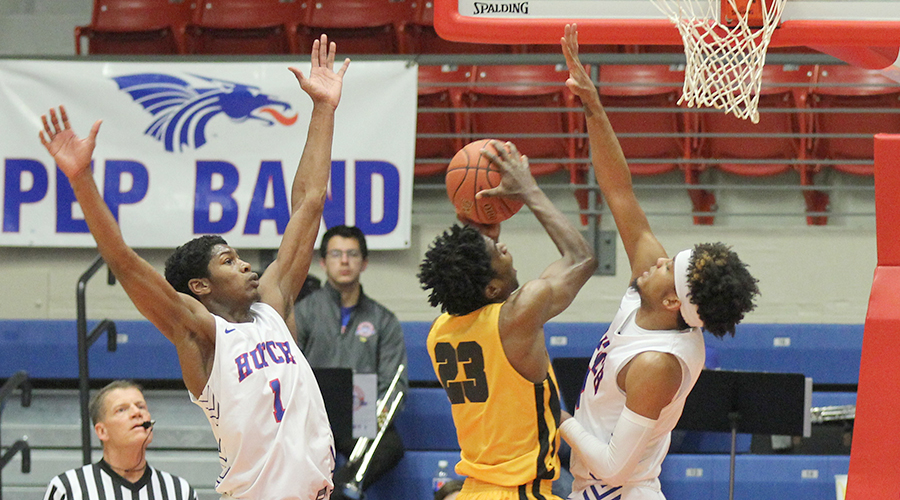 D.J. Mitchell (right) and Saquan Singleton (left)  go high to defend a Cloud County shot in the second half of the No. 6-Blue Dragons 90-75 Jayhawk Conference victory over Cloud County on Wednesday at the Sports Arena. (Bre Rogers/Blue Dragon Sports Information)