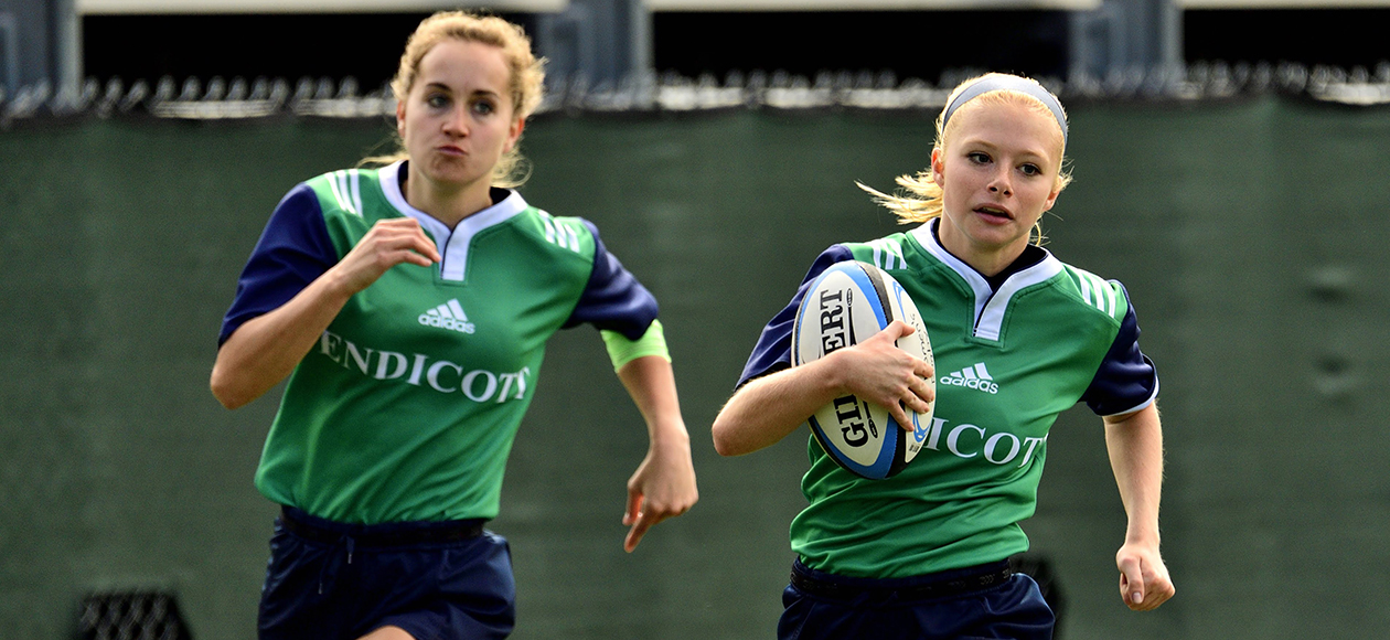Women's rugby game action.
