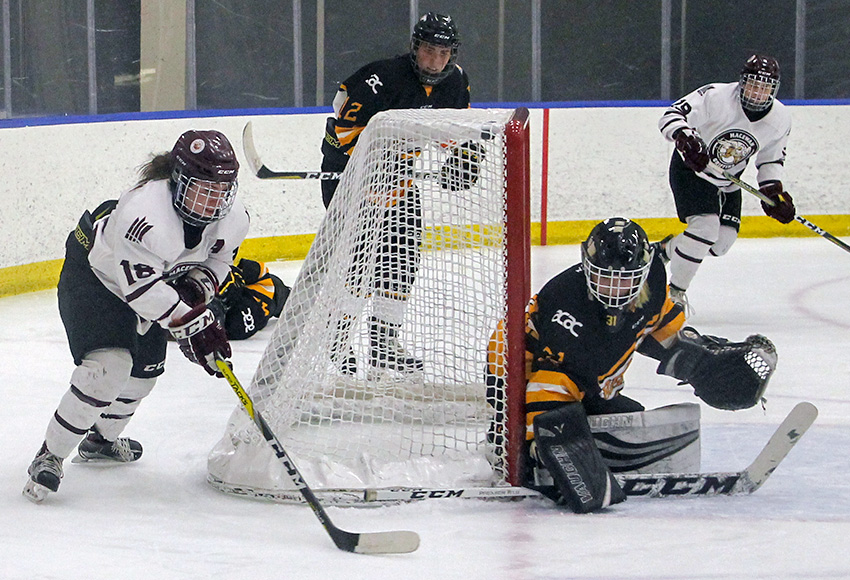 Morgan Casson attempts to score on Olds goaltender Lexi Bruce during action between the teams last month at the Downtown Community Arena. Bruce made 34 saves to stymie the Griffins 2-1 (Melbourne Disbrow photo).