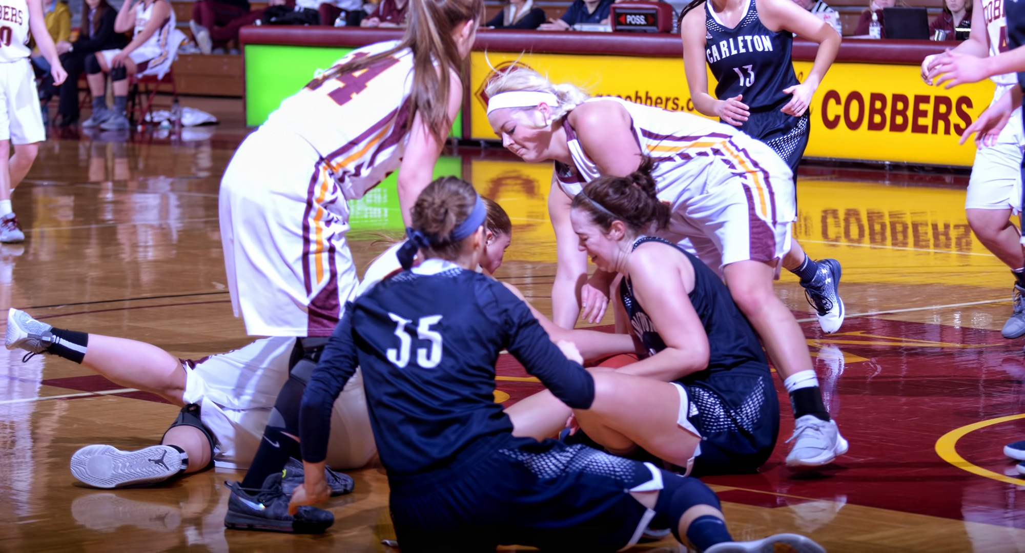 Players scramble to get control of the ball during the second quarter of the Cobbers' game with Carleton.