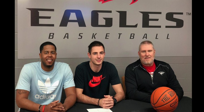 Stefan Nakic is flanked by Polk State Head Coach Brandon Giles (left) and Florida College Head Coach Pat Todd (right) after signing letter of intent to continue his academic and athletic career at Florida College.