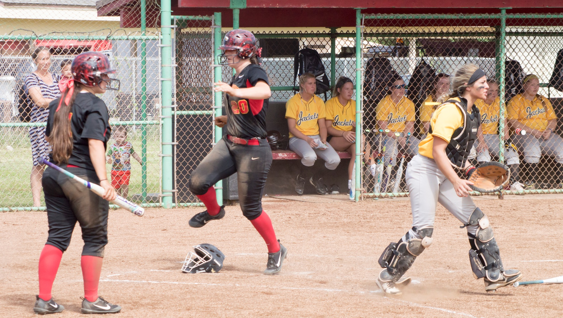 Alanna Anderson crosses the plate against Baldwin Wallace. Her 2-RBI single against Azusa Pacific in the bottom of the sixth brought in the winning run.