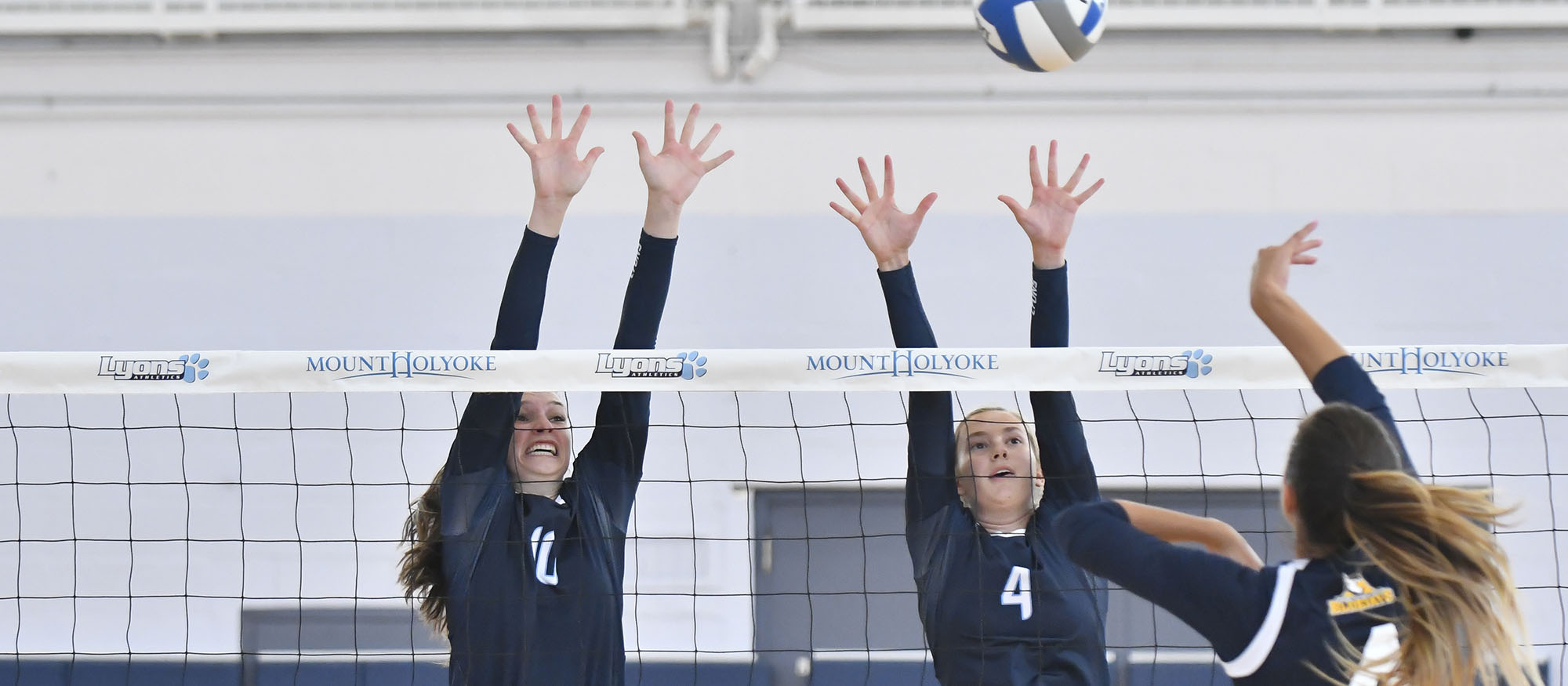 Action photo of Lyons volleyball players Sarah Caggiano and Joy Maran