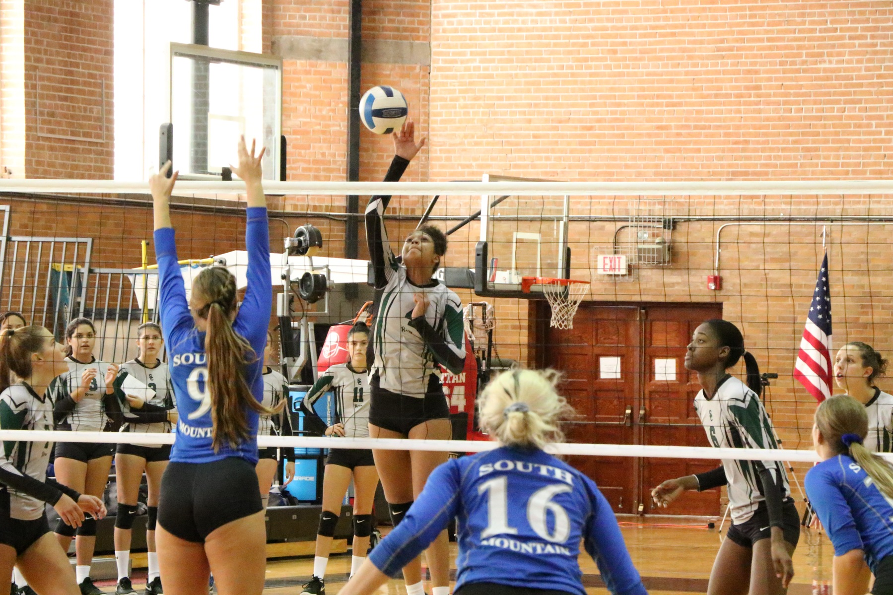 Yanlis Feliz goes up for a kill in set two, versus South Mountain Community College