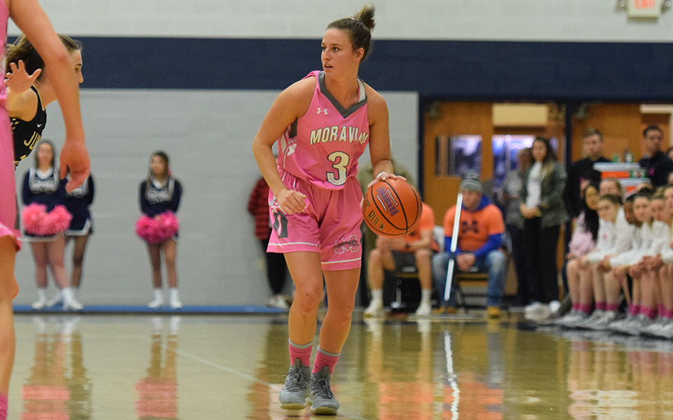 Senior guard Maddie Capuano looks to run the offense during the first half versus Juniata College in Johnston Hall.