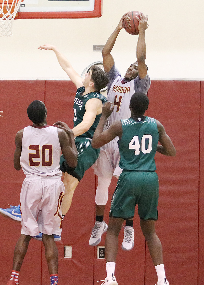Lancer Giovonni Jackson grabs the rebound during PCC's playoff loss to Cuesta Wednesday night, photo by Richard Quinton.