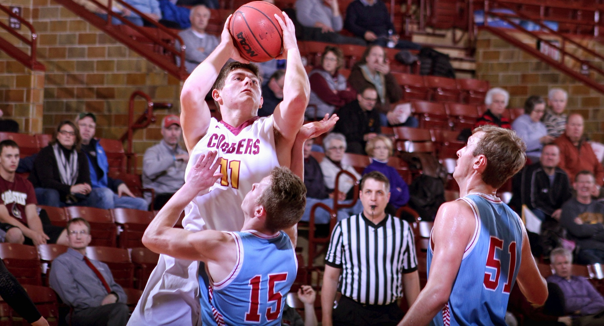 Senior Dylan Alderman drives to the basket during the first half of the Cobbers' game with St. John's.