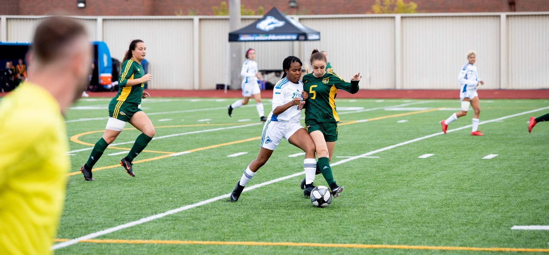 Brianna Samuels-McLaughlin battles for ball with #5 Durham College