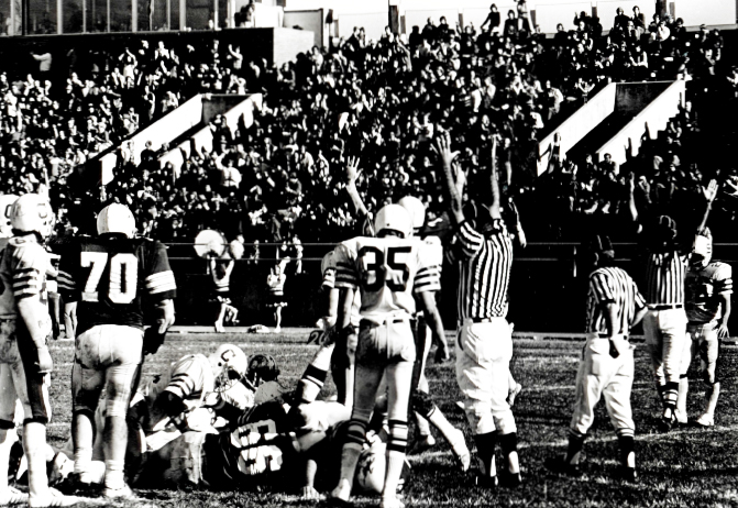 Jim Bailie and Rod Drury help lead Evangel to a score against Culver-Stockton winning 20-19 on November 12, 1977.