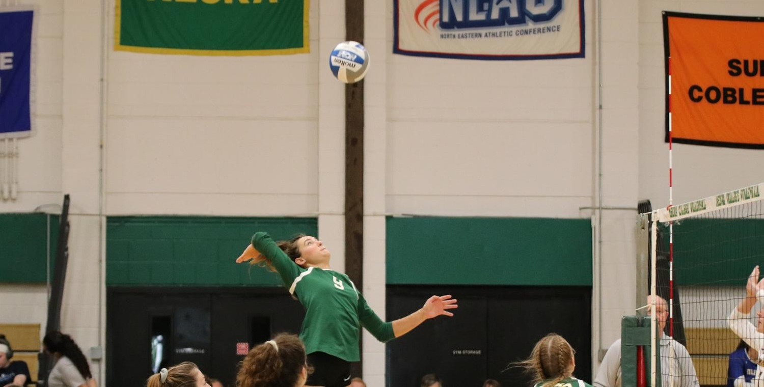 Grace Allen (9) led the Wolves with 14 kills on Wednesday -- Photo by McKenzie Erne '21