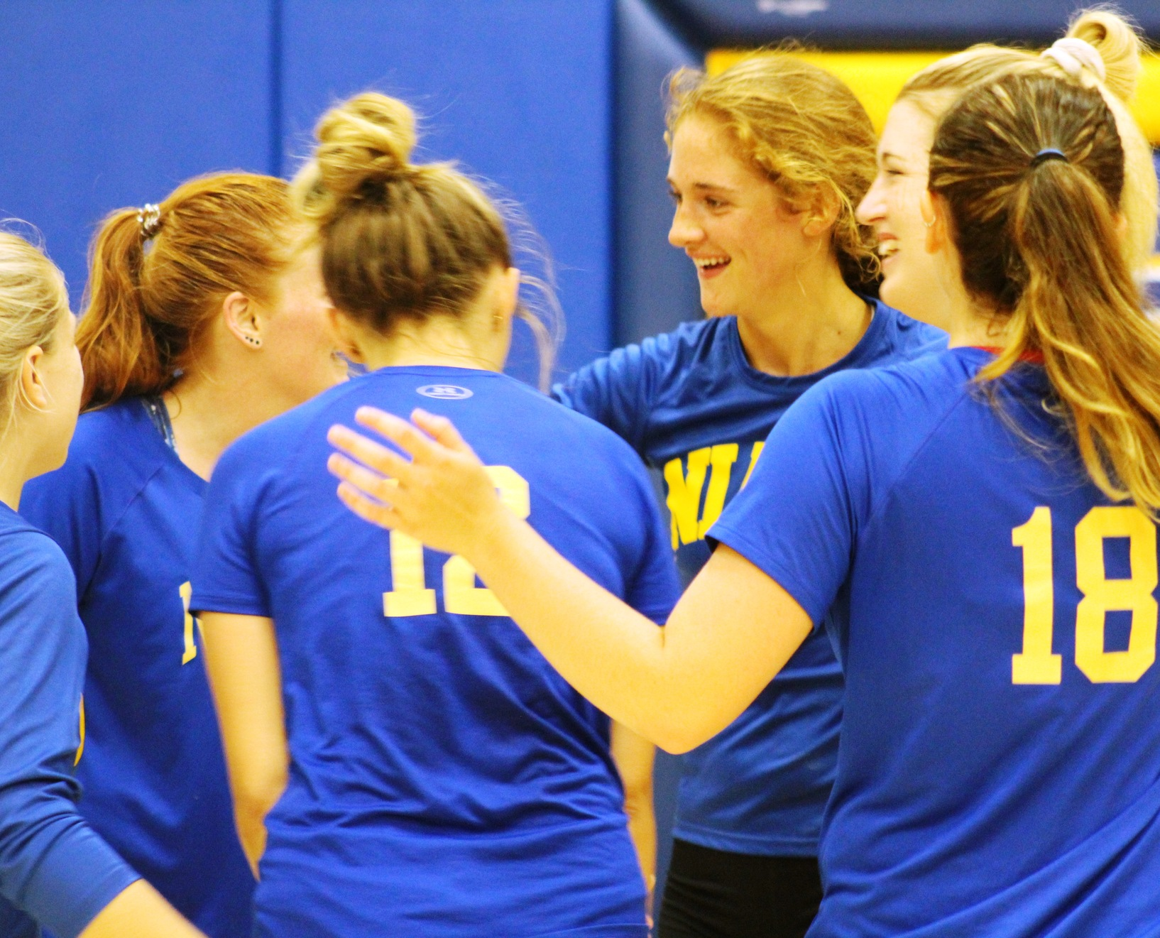 NIACC players celebrate a point in last Friday's scrimmage against Iowa Central.
