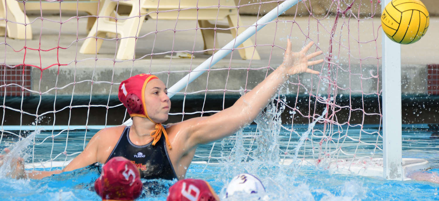 Chandlyr Denaro makes one of her three saves on Saturday against Cal Lutheran. (photo credit: Mitch Allan)
