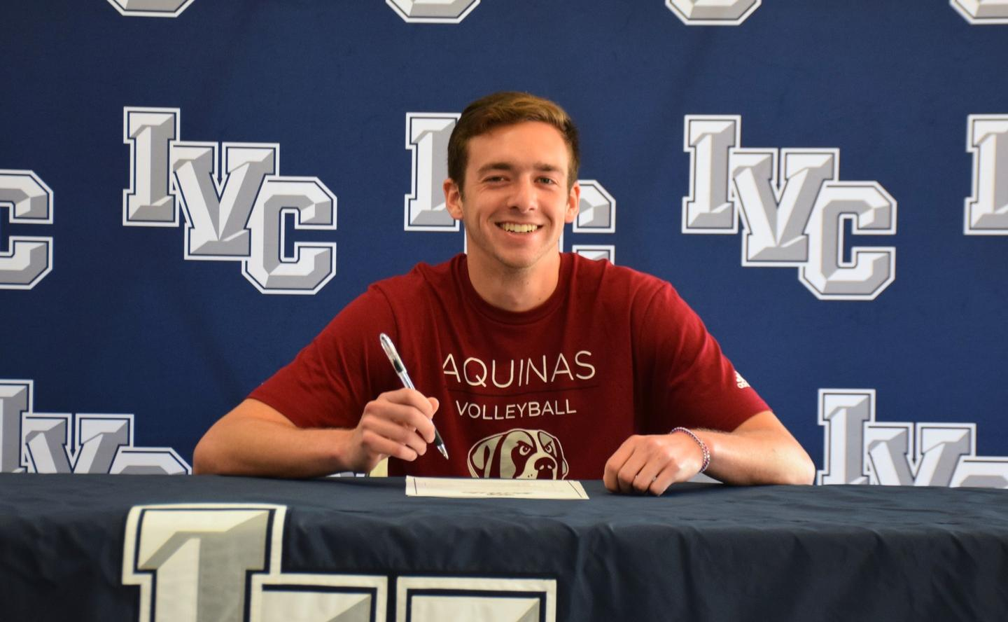 Men's volleyball player Ruben Lopez signs with Aquinas