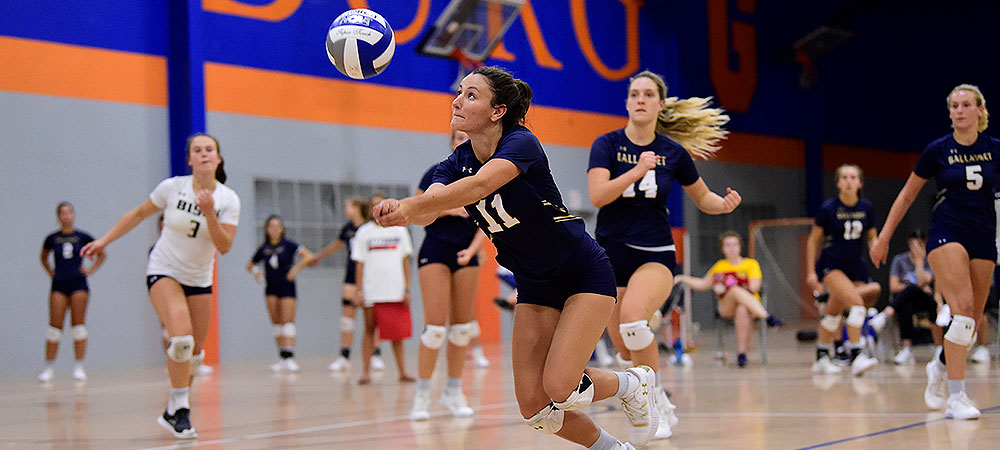 GU's Demi Bingham tracks down a loose ball to make the dig in a volleyball match