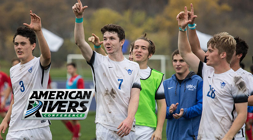 Luther men's soccer players hold up one finger.