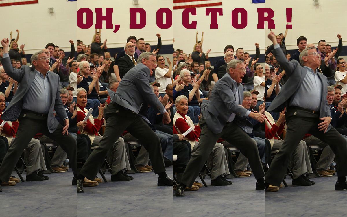 THE DOCTOR MAKES A HOUSE CALL: E-Club Hall of Famer Dr. David Yeo, athletic trainer emeritus, celebrates a crucial three-point, second-half field goal by Kendall Marquez that gave the Warriors a 56-51 lead with 12 minutes left in the game. Marquez and Keene State transfer Jake Collagan each had four three-pointers and combined for 46 points to power the Warriors to their 37th straight Little East Conference regular-season home win and reduce the magic number to 1 for their fifth straight LEC title and tournament's top seed. (Photo by Nick McAneny)