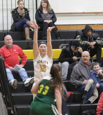 SUNY Broome women's basketball player taking a jump shot from the corner