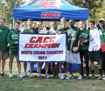 The men's cross-country team poses with the 2011 CACC championship banner (Kirk Reed).