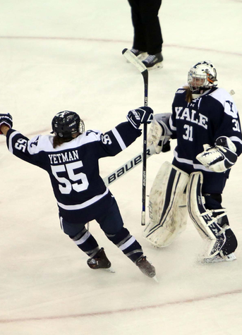 Julia Yetman and Tera Hofmann celebrate the shootout win. (photo by Sam Rubin '95, Yale Sports Publicity)