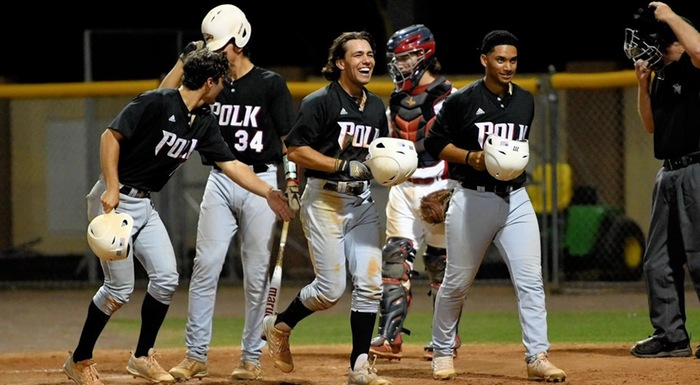 Danny Berg (center) celebrates after hitting a three-run home run. He had six RBI in Polk State's 16-0 win over Florida Southern JV. (Photo by Tom Hagerty, Polk State.)