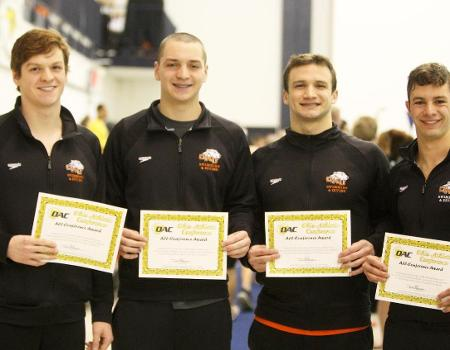 Two school records fall as Men's Swimming & Diving holds lead after Day 2 of OAC Championships