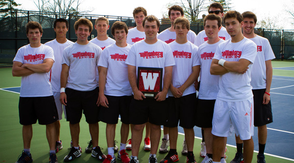 The 2012-13 Wittenberg men's tennis team surrounds Stuart Zorn as he receives his Senior Recognition Award prior to the Tigers' match against Denison. Photo by Erin Pence
